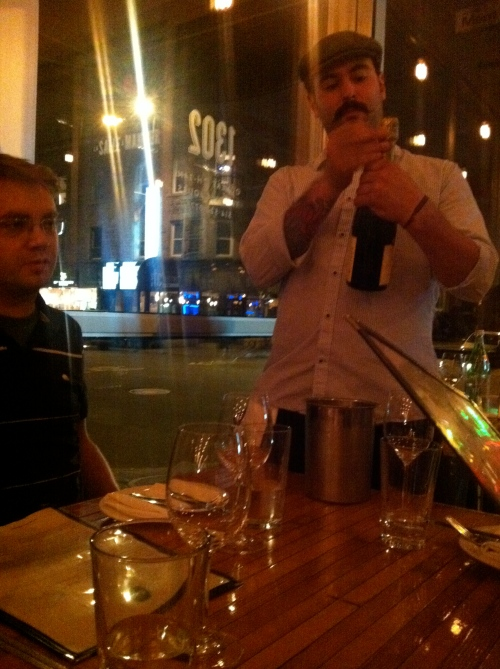 Getting ready to serve the sparkling wine. The server had an awesome moustache. I imagine that he'd twirl the ends of it and laugh maniacally as he plotted something devious.  That is all.