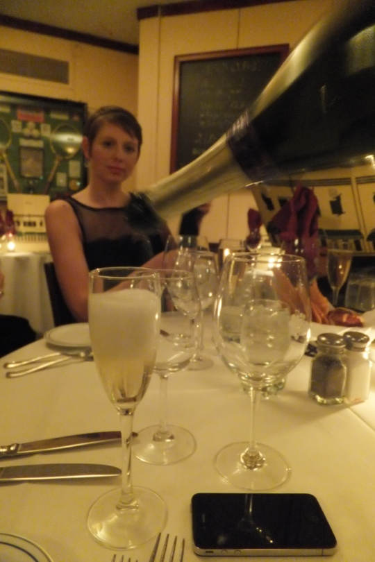 Pouring the bubbly - the first of four different wines - all bottomless.