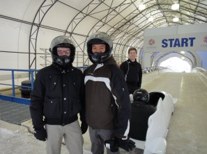 Rick and me, just before jumping into the sled and hurtling ourselves down the mountain.