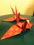 Paper cranes silently judge our tea ceremony skills.