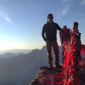 At the top of the east peak of Huashan - on the side of the protective fence that I probably shouldn't be on.
